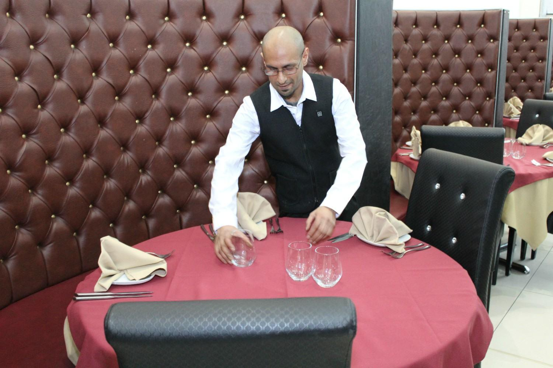 Aziz Khan at work inside the restaurant.