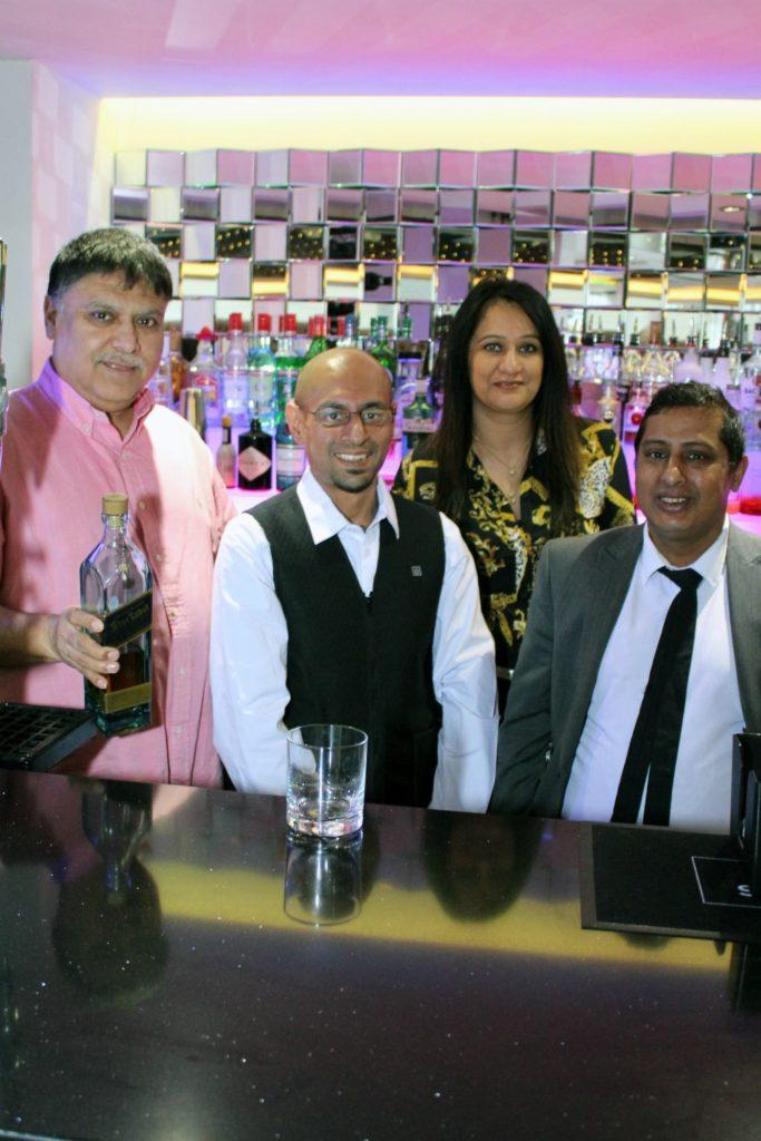 (from left) Dilbar owners Vijay and Pam Bassi (left and third left) with Aziz Khan (second left) and Dilbar manager Ahad 'Raj' Uddin (right).