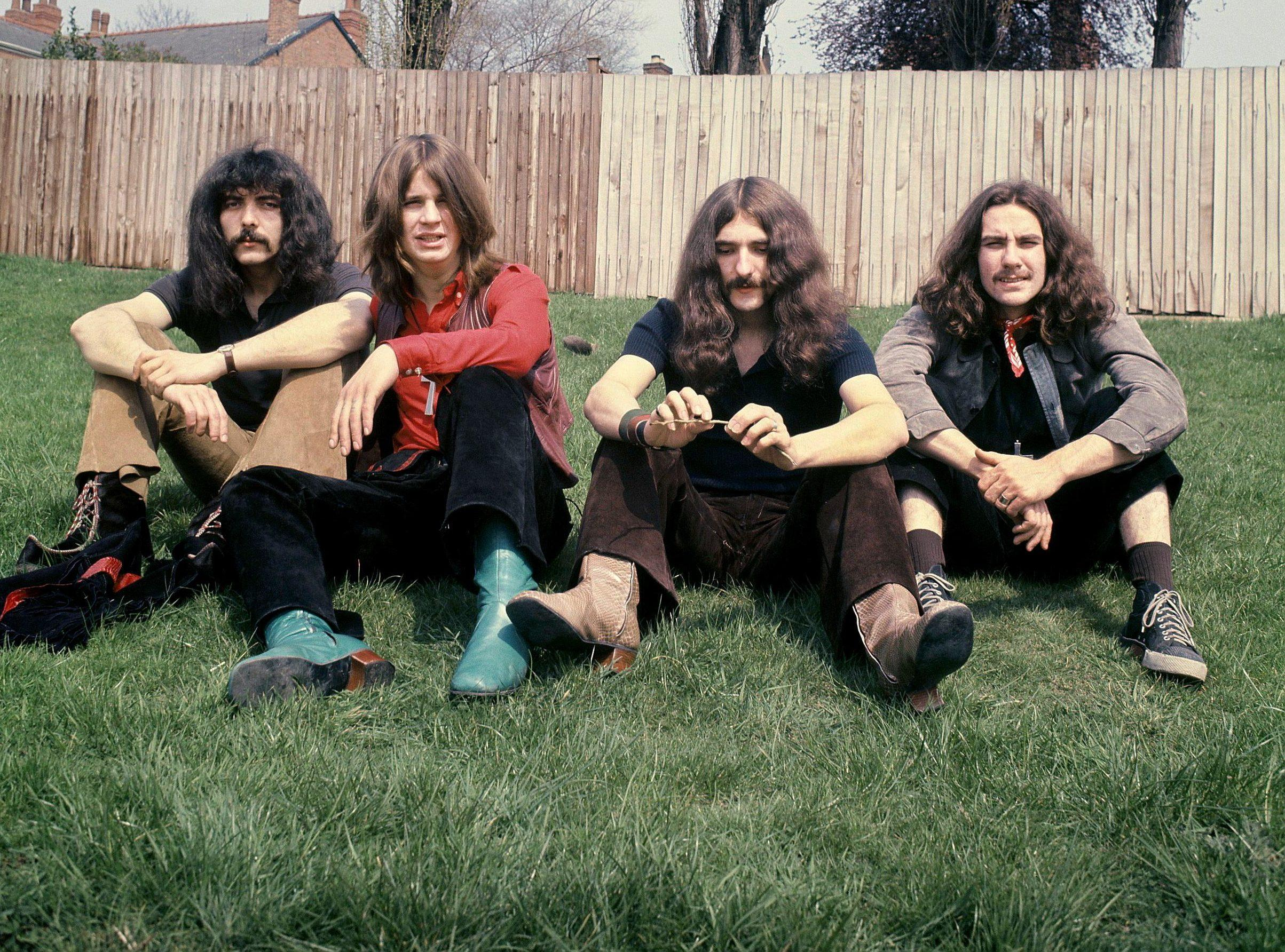 Black Sabbath pictured in their early years by Jim Simpson outside his home in Edgbaston