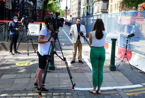 Media world descends on Westside to report on safe distancing pavement markings